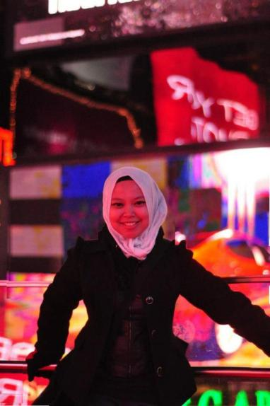 In a Pashmina and freezing my brains out in Times Square, New York City.