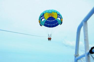 The said outfit, parasailing near Mamutik Islands