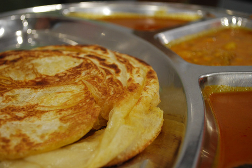 A first date over roti boom and sunny side ups.